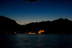 Sky and mountains at night. Lights of town at distance. Uncover the secrets of island Royalty Free Stock Photos