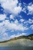 Sky, mountains and sea. View of a sea coast, mountain and sky Stock Photos