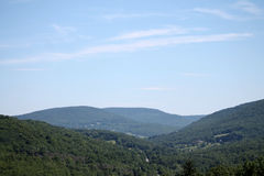 Sky in the in the mountains. A view of a cloudy sky through the trees in the Catskills Stock Image