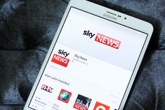 Sky news app logo. Downloading sky news application from google play store on samsung tab s2 stock photo