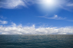Sky and ocean. The plane over the ocean Royalty Free Stock Images