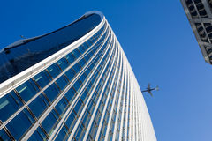 Sky, office building and Airplaine. Collision royalty free stock image