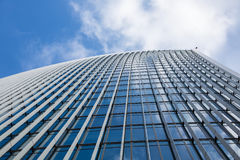 Sky and office building. A clouds reflection in glass wall of business building stock photos