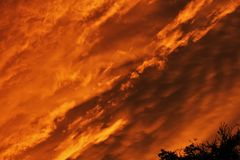 Sky On Fire! Cloud After Rain During Twilight Hours Royalty Free Stock Image