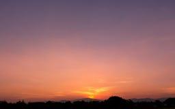 Sky. Orange and purple light in sundown sky with black mountain Royalty Free Stock Photos