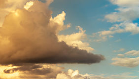 Sky. Orange and shadow on clouds with blue sky Royalty Free Stock Images