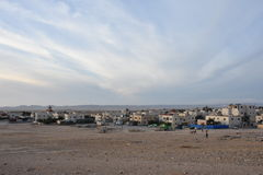 The sky over the desert and the village in Israel Royalty Free Stock Photo