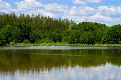 The sky over the lake. Village Bazarny Karabulak, Saratov region. The Central pond Stock Image