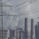Global Warming - Grey Sky and Smoke over Power Station, Germany Royalty Free Stock Photos