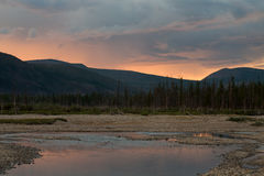 The sky over the river in the sunset light. River Labynkyr. Yakutia. Russia stock image
