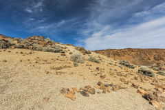 The sky over a stone desert. Only rocks, sand and sky you can see in a desert valley at the foot of the volcano Teide on Tenerife. Spain Stock Images