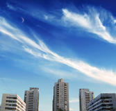 Sky over urban district. Fleecy clouds over district of city Stock Photo