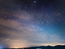 Sky over Venosa. A sky with stars and clouds over a small city in the south of Italy stock images