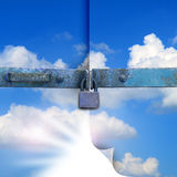Sky padlock. A white open hole in the sky behind lock Royalty Free Stock Photos