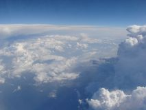 Sky panorama of the aircraft illuminator at an altitude of 9000 m above sea level. Panorama of an infinite snow-white cloudy field on the background of sky blue stock photos