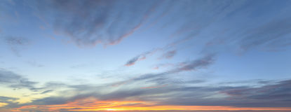 Sky panorama at twilight time. Panorama of a blue cloudy sky at sunset Royalty Free Stock Photo