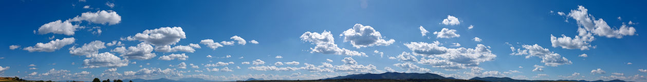 Sky panorama. Wide sky panorama with scattered cumulus clouds Stock Photography