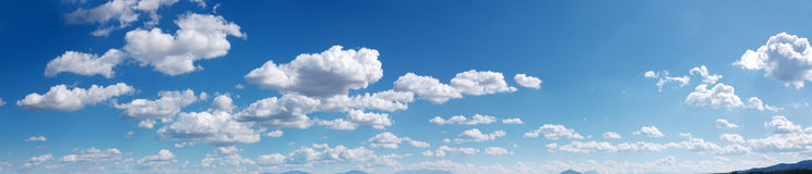 Sky panorama. Wide sky panorama with scattered cumulus clouds Stock Image