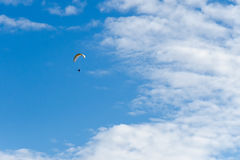 Into the sky. Paraplane in the blue sky with clouds Royalty Free Stock Photos