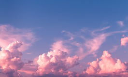 Sky. Pink and purple cloudscape in azure sky Stock Photos