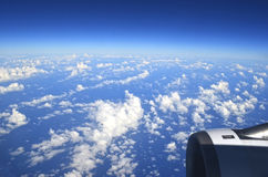 The sky from a plane. Clouds in the blue sky stock image