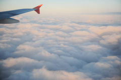 The sky from the plane. Clouds and a plane wing at big height Royalty Free Stock Images