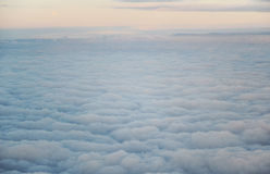 The sky from the plane. The cloudy sky from a plane cabin at big height Royalty Free Stock Photography