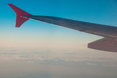 Sky and plane wing Stock Photography