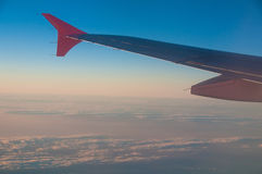 Sky and plane wing Stock Photos