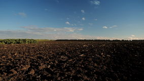 Sky and a plowed field stock footage