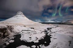 Sky Portal. Aurora Borealis over Kirkjufell, Iceland Stock Photo