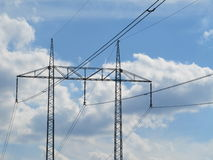 Sky. Power lines to the substrate sky and puffs in nature stock image