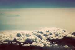 Sky with puffy clouds in vintage, retro style Royalty Free Stock Images