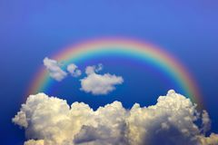Sky and Rainbow. Rainbow rising above high clouds Royalty Free Stock Photography