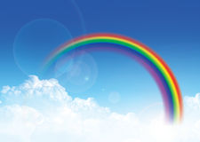 Sky and rainbow. Cloudy blue sky with colourful rainbow Royalty Free Stock Photography