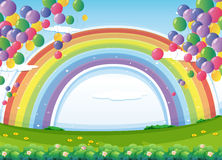 A sky with a rainbow and colorful floating balloons Stock Image