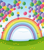 A sky with rainbow and group of floating balloons Royalty Free Stock Photos