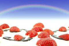 Sky with rainbow over strawberries Royalty Free Stock Photography