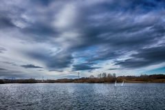 Sky before raining. Lake water park garden autumn landscape trees nature  wideangle countryside day travel sky cloudy clouds yacht ruffle winter Stock Images