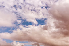 Sky. Red brown clouds with blue sky Royalty Free Stock Image