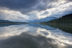 Sky reflected in alpine lake Royalty Free Stock Photos
