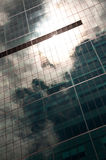 Sky Reflected in Building. Stormy sky reflected in a modern glass office building Stock Images