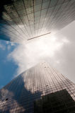 Sky Reflected in Building. Stormy sky reflected in a modern glass office building Royalty Free Stock Image