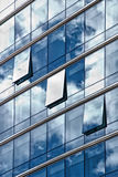 Sky reflected in buildings windows. With clouds Stock Photos