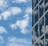 Glassy Sky. The sky reflected in a buildings windows stock image