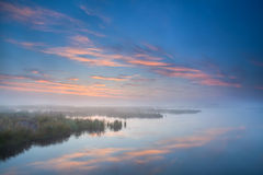 Sky reflected in lake at misty morning Royalty Free Stock Photography