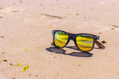 Sky is reflected in sunglasses, beach Stock Photography