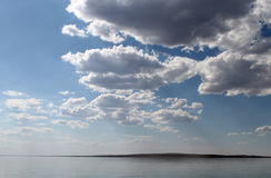 The sky reflected in the water, deserted beach lake, summer sky, nature, blue cloud,. Deserted beach lake, summer sky, nature blue cloud, Tuva, the sky reflected Stock Photography