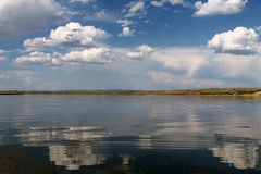 The sky reflected in the water, deserted beach lake, summer sky, nature, blue cloud,. Deserted beach lake, summer sky, nature blue cloud, Tuva, the sky reflected Stock Images