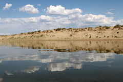 The sky reflected in the water, deserted beach lake, summer sky, nature, blue cloud,. Deserted beach lake, summer sky, nature blue cloud, Tuva, the sky reflected Royalty Free Stock Photo